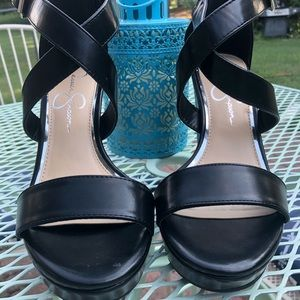 Jessica Simpson black leather wedge shoes.
